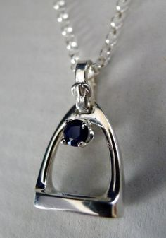 Super popular sterling silver and sapphire stone pendant going to NY. Enjoy!  Here is info:   http://www.equestrianjewelry.com/kd-sterling-silver-stirrup-with-sapphire-pendant-necklace/