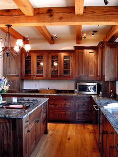 Want beams like this on my kitchen ceiling. I also love the dark woods and granite counter tops!