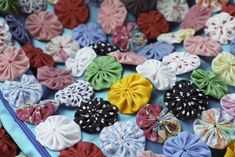 Learn how to make a Yo-Yos quilt from little round pieces of fabric. Use yo-yos to make an entire quilt or try them to create as 3D applique.