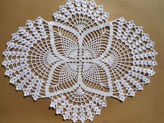 Handmade crochet doily color - white size -17 inches ( 43 cm . ) by 13 inches ( 33 cm . )