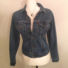 """Levi Strauss Denim Jacket Authentic Authentic Levi Strauss Denim Jacket fits like a size Womens Small. I found this Boys size 16, about fifteen years ago. It was the Perfect denim blue! Photo 2 shows that it measures 18"""" across the chest. I have only worn this a few times since I bought it, as it no longer fits me. Very good condition from my non smoking home. Levi's Jackets & Coats Jean Jackets"""