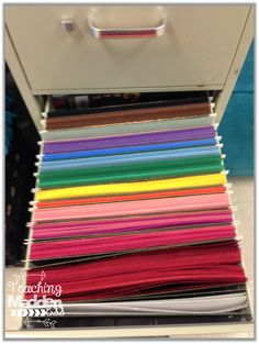 Organize construction paper, card stock, and colored copy paper in file cabinet drawers for easy access!!