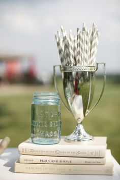 Straws in a trophy cup, maybe to sit on the bar