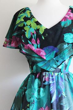 Vintage 1980s does 1950s style black and green floral party dress