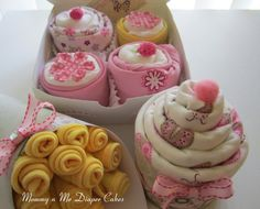 Baby shower gift/decor - diaper wrapped with onesie cupcakes, washcloth bouquet, receiving blanket cupcake (Etsy)