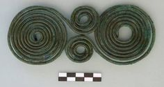 Lofkënd Archaeological Project: Large bronze spectacle fibula from Tomb 17 (dated from the 11th/10th through the later 7th or 6th centuries B.C)