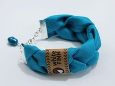 ($14.00) These chunky braided soft fabric bracelets are secured with silver metal closures and attach with silver chain and a lobster clasp. Each bracelet also has a turquoise charm at the end of the chain.