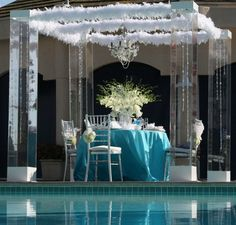 Clear mandap frame with feathers - white and turquoise    Love this and an alternative mandap - very light and airy!