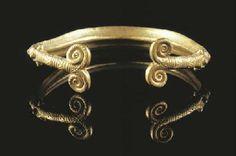 A EUROPEAN BRONZE AGE GOLD DOUBLE SPIRAL BRACELETS                                                                                                                                                                       13TH CENTURY B.C.
