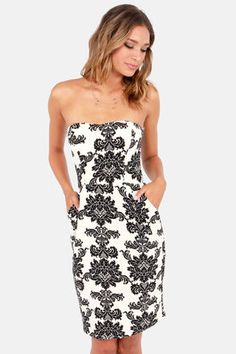 class never goes out of season. This slimming dress will surely show off your curves but don't be surprised when you are mistaken for a royal. #lulus #holidaywear  Pattern Cake Black and Ivory Damask Print Dress at LuLus.com!