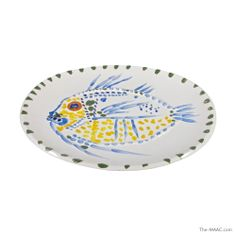 "Picasso Signed and Numbered White #Fish #Platter, Spotted yellow and blue fish with orange eye on glazed oval dish--white earthenware clay, decorations in oxides--yellow, green, orange, and blue on white white enamel. Green dots along rim (some ""firing"" pops). #Signed and numbered on back,5/100 ""Edition Picasso #Madura"" Glazed white #earthenware, #France, 1952, excellent condition.   http://the-maac.com/leah-gordon?id=67&tid=3816"