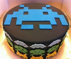 Space Invaders take over the groom's cake! Geeks get it done w/ these amazing #wedding cake designs via @themanregistry