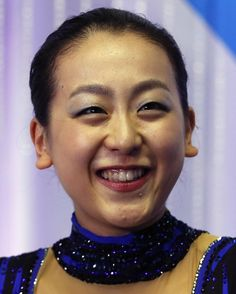 Asada of Japan smiles after performing during the women's free skating programme at the ISU Grand Prix of Figure Skating in Tokyo