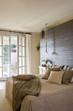 Tile wall in Spanish bedroom; Manu Nuñez