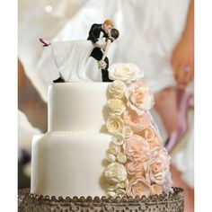 Romance that sweeps one off of their feet? This cake topper's got it. Immortalize the lucky couple's love with this cute wedding cake topper from Wedding Star.