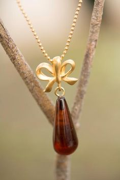 Delicate Baltic Amber Drop Pendant with Gold-Plated Sterling Silver Chain close