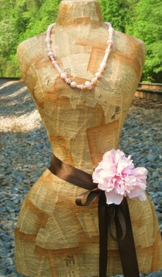 I want to do one of my dress forms with old book pages.