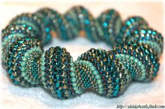 RESERVED Turquoise ocean waves cellini spiral blue by Shinkabeads, €40.00