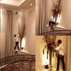 Extreme floral design. Because sometimes, the ladder can't reach. #c2mdesigns #floral #floraldesign #florist #stunting #shelf #ledge #edge #heights #nofear #howdidshegetupthere #notaninchtospare #tall #mylifeintheair #birch #autumn #elfontheshelf #grandstaircase #hotel #installation #loadin #progressphoto #uplighting #designsthatrock Designer: #christinemccaffery #rhodeisland #boston #willtravel
