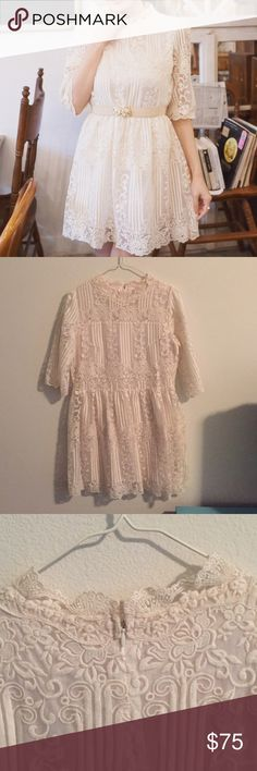 "NWOT High neck lace dress Gorgeous lace dress with high neck. Back zip. Ivory color, with intricate lace details. Inner lining. Fits like XS. Measures about 29"" from shoulder to hem. Brand new. Dresses Mini"