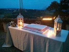 white lanterns pink roses and cake table millefoglie typical Italian wedding cake!