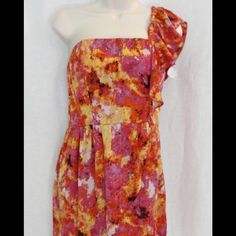 "WEEKEND OFFER GIANNI BINI  SHOULDER (PRICE DROP) Gianni BINI pink orange one shoulder short dress. Sleeve style is one shoulder. The material is polyester. The strap length is approximately -6"".  The length of the dress is approximately 24"" - 25"". Gianni Bini Dresses Mini"