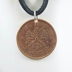 Necklace made with a 1921 Japanese coin.