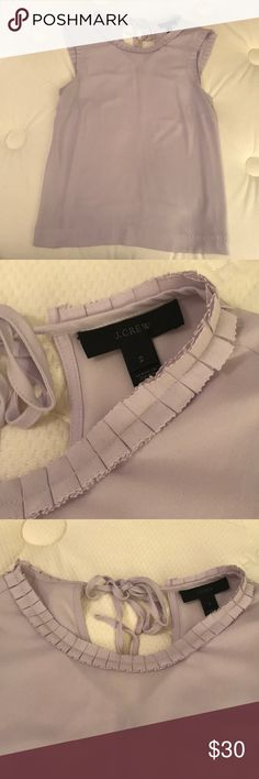 J.Crew Drapey Ruffle Trim Top - Lavender In excellent condition. Worn only one time.  PRODUCT DETAILS The top that instantly pulls together any outfit, thanks to its drapey, silk-like fabric and ruffly trim.  Poly. Machine wash. J. Crew Tops Tank Tops