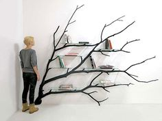See How Artist Transformed Fallen Tree Branch Into Beautiful Bookshelf
