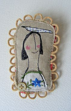 Handmade Brooch.  Made from vintage embroidered linen. Free machine embroidered girl and bird design.    Stitched to a piece of old quilt for backing.