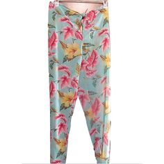Victoria's Secret Sz L Floral Chiffon Beach Pants Victoria's Secret Sz L Turquoise Floral Chiffon Beach PantsSize L Hawaiian flower waist tie beach pants. Turquoise floral print wide leg pantsPerfect for the beach or pool.EUC No tears or marks. May fit a size XL. Adjust at the waist. Victoria's Secret Pants