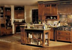 """Medallion Oak Park custom cabinets -- these will be delivered on 05/14/2015 Shaker or Mission style cabs - dark glass on top with """"puck"""" LED lights"""