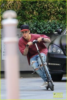 Justin Bieber Steps Out After Cancelling Thanksgiving Appearances: Photo #898543. Justin Bieber bends down low while going for a ride on a scooter outside of the W Hotel in West Hollywood on Tuesday (November 24). The 21-year-old singer was…