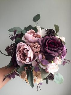 fall wedding ideas This silk wedding bouquet with it's purple, plum and dusty rose tones would add the perfect touch to any fall wedding. This handmade bouquet is made with plum ros Silk Bridal Bouquet, Purple Wedding Bouquets, Fall Wedding Flowers, Rose Bouquet, Wedding Colors, Fall Wedding Purple, Bridal Bouquets, Wedding Ideas, Wildflowers Wedding