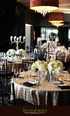 I like the satin champagne tablecloths with the white detail paired with the Black tiffany chair.  Classy