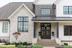 Shingle siding accent, limestone, metal roof with wood posts. Different color exterior paint- little darker