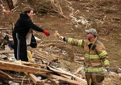 This touching moment is in our Day 3 photo gallery of Kentucky storm coverage. Click the photo to see the full gallery.