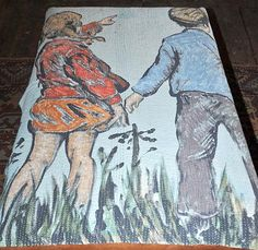 A DAVID BROMLEY COTTON THROW WITH A DEPICTION OF TWO CHILDREN AT PLAY $500 - $700