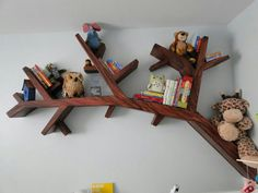 Kids bookshelf I would want coming out of the tree painted on the wall!