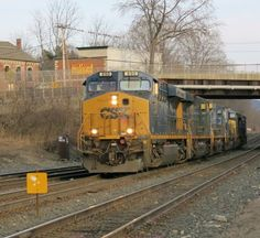 A CSX power move chugs along through Palmer, MA. led by a CSX ES44AH 890.