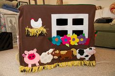 This is brilliant!!!  A card table play farmhouse.  It also double as an activity centre.  Some parts can be taken on and off with velcro.  Kids could harvest vegetables.  for more learning opportunities the flowers could have shapes inside them and be made of the basic primary colours. Veggies could have numbers on them for counting and number recognition.