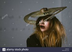 Stock Photo - Portrait of fashion model wearing cymbals hat -    away, blonde, cloth, couture, cymbal, cymbals, dress, drum, drums, extravagant, face, fashion, hat, haute, haute-couture, high, horizontal, inside, instruments, looking, model, music, people, photo, portrait, posing, pretty, serious, set, shoot, shooting, shot, sitting, studio, stylish, trendy, up, urs siedentop, woman