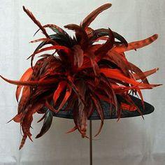 Large feather orange & black hat