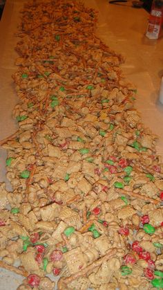 """""""Stacy's sweet and crunchy Christmas crack snack mix""""...Chex, peanuts, pretzels, cheerios, M's covered in Ghirrardelli white chocolate and creamy peanut butter...OMG!"""