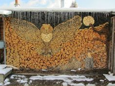 How to Procure Firewood-is the title of this.  Built by the people of Rybinsk, Russia, they broke the world record for the largest stark of wood in the world.  72.12 feet high.  Love the logs, hatchet, tree, moon and owl added.