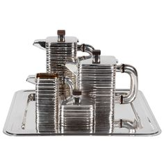 American Art Deco Sterling Coffee and Tea Set on Modernist tray c. 1935 | From a unique collection of antique and modern sterling silver at http://www.1stdibs.com/furniture/dining-entertaining/sterling-silver/