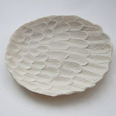 white plate by Lisa Stevens, unglazed porcelain art # ceramic I like this because it is a very plain colour and it is unglazed which will leave a rough texture on the plate. Ceramic Clay, Ceramic Plates, Porcelain Ceramics, Fine Porcelain, Porcelain Skin, Porcelain Doll, Ceramics Projects, Clay Projects, Pottery Plates