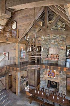 Same house in Montana. Has a castle-like feel with the stone work, iron chandelier, and long dining table.  KJC