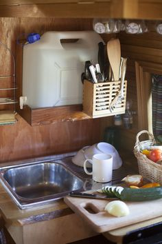 Easy and small sink solution. With a drain 5 gallon bucket below...or use a solar shower!