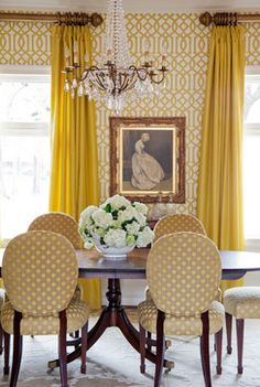 Polka dot chairs add whimsy to a formal dining room.